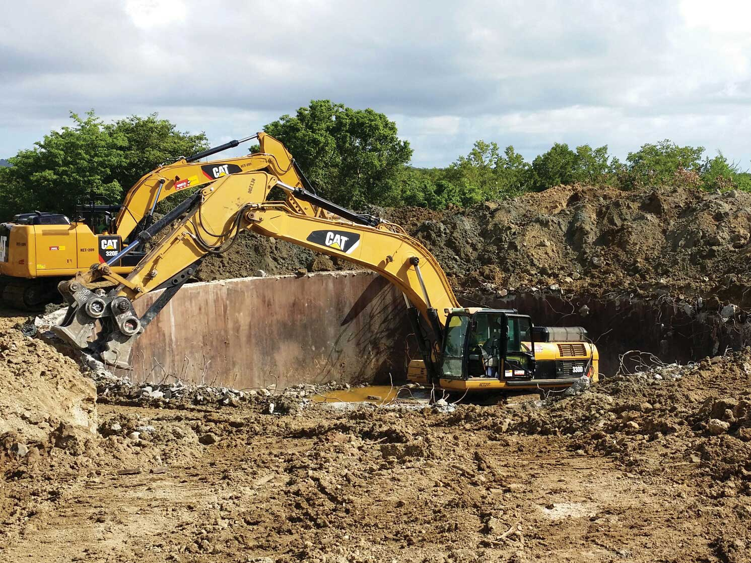 Excavator digging a big hole