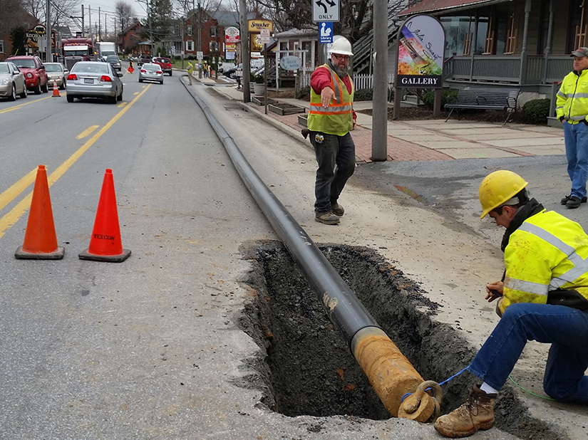 Water supply pipeline installation in downtown streetscape