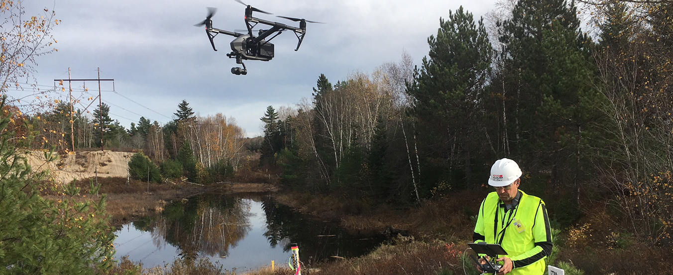 UAS technician operating drone in pipeline setting
